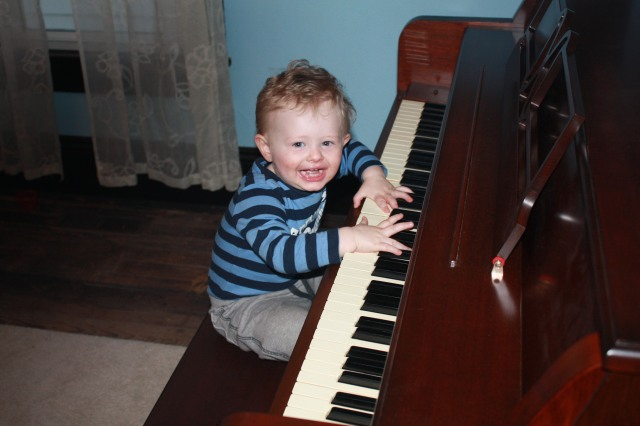 toddler plays piano
